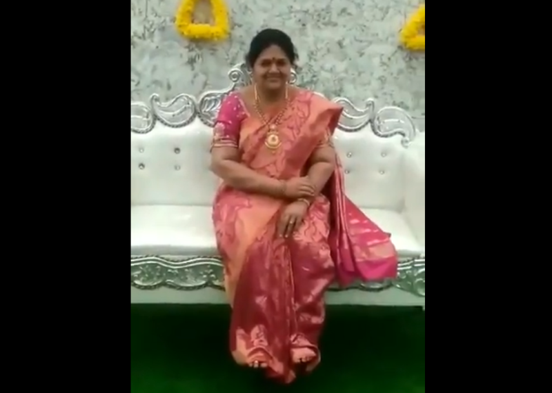 A lifelike statue of Madhavi sitting on a couch at the housewarming ceremony. — Twitter screengrab