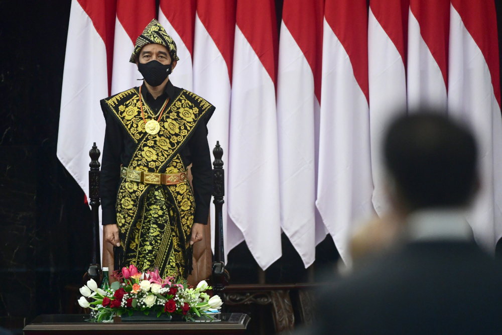 Indonesian President Joko Widodo dressed in a traditional Indonesian costume from Sabu, stands before delivering a speech ahead of the 75th Independence Day, at the parliament building in Jakarta, Indonesia, August, 14, 2020. — Indonesian Presidential Palace/Muchlis Jr handout pic via Reuters