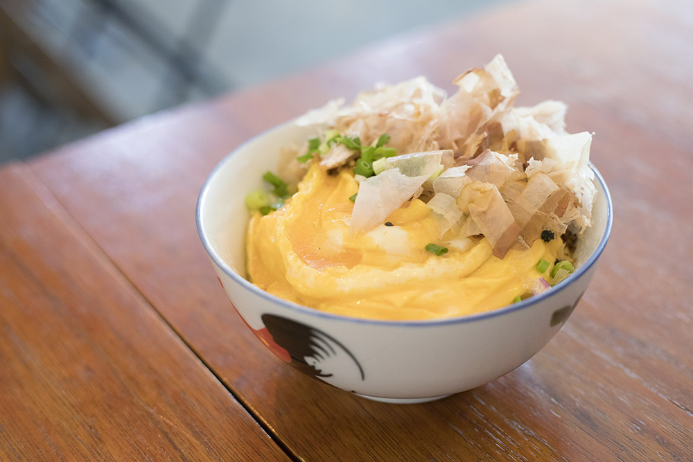 Ebony & Ivory's signature rice bowl – filled to the brim with creamy scrambled eggs and umami-tinged bonito flakes.