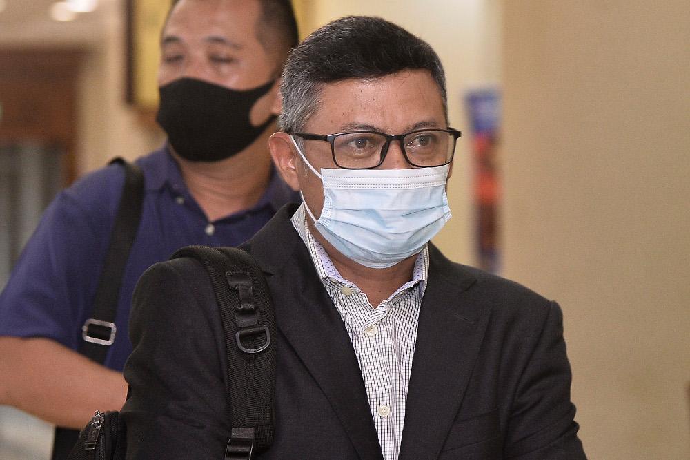 Former 1MDB CEO Mohd Hazem Abdul Rahman at Kuala Lumpur High Court for the 1MDB trial September 10, 2020. — Picture by Miera Zulyana