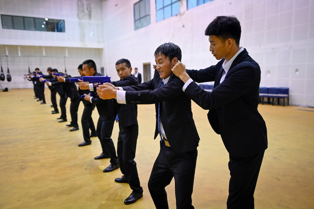 This picture taken on September 8, 2020 shows an instructor correcting a trainee's action during a training session at the Genghis Security Academy in Tianjin. — AFP pic