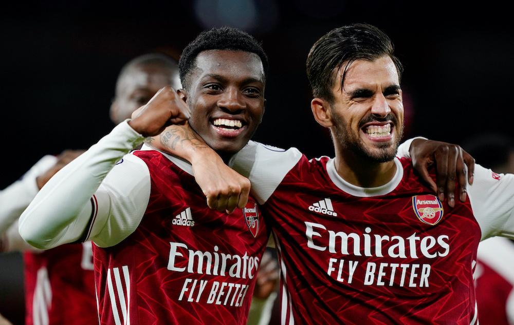 Arsenal's Eddie Nketiah celebrates scoring their second goal with Dani Ceballos, September 19., 2020. — Pool via Reuters/Will Oliver