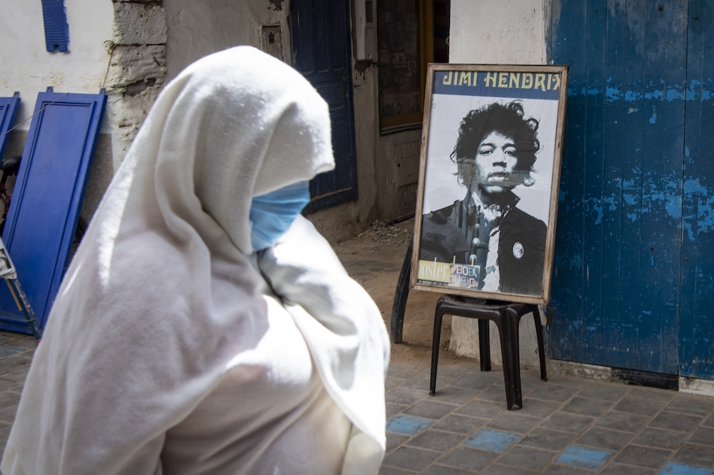 A picture taken in the Moroccan coastal city of Essaouira shows portraits of late US guitarist Jimi Hendrix. — AFP pic