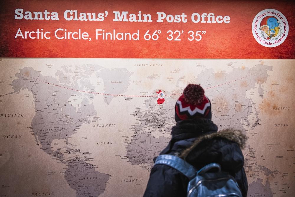 Tourists visit Santa Claus' post office at Santa Claus Village near Rovaniemi, Finnish Lapland. — AFP pic