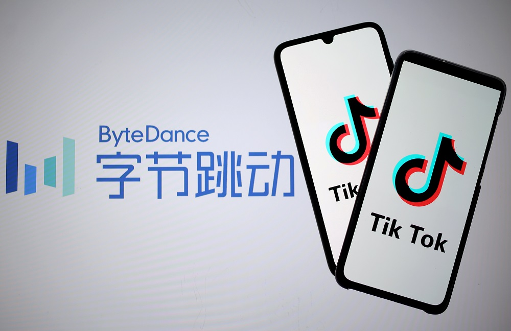 Tik Tok logos are seen on smartphones in front of a displayed ByteDance logo in this illustration taken November 27, 2019. — Reuters pic