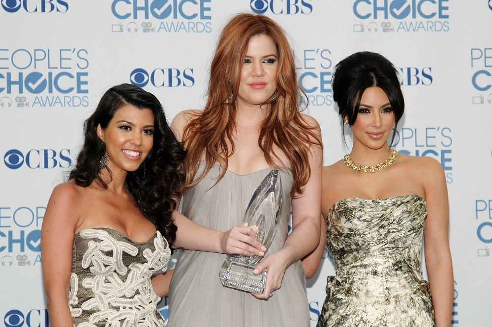 Reality television sisters (from left) Kourtney, Khloe and Kim Kardashian pose with their favorite guilty pleasure award for 'Keeping Up with the Kardashians' at the 2011 People's Choice Awards in Los Angeles January 5, 2011. — Reuters pic