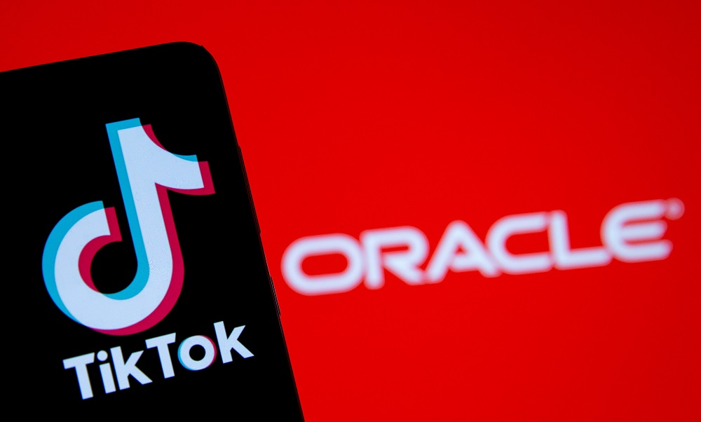 A smartphone with the Tik Tok logo is seen in front of a displayed Oracle logo in this illustration taken, Septemeber 14, 2020. — Reuters pic