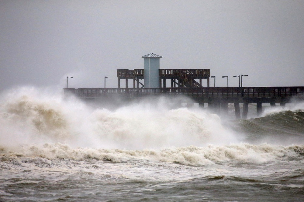 Waves crash along a pier as Hurricane Sally approaches in Gulf Shores, Alabama September 15, 2020. — Reuters pic