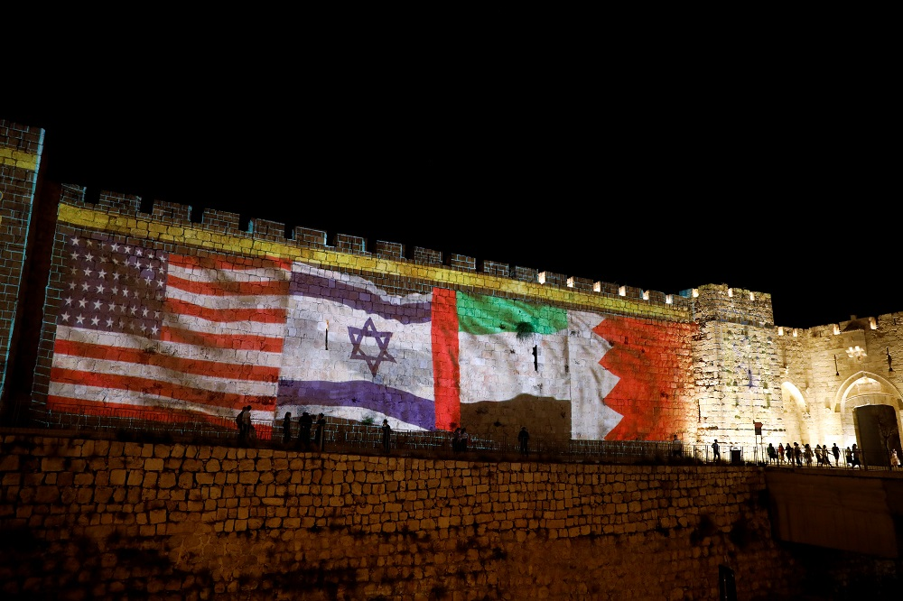 The flags of the United States, Israel, United Arab Emirates and Bahrain are projected on a section of the walls surrounding Jerusalem's Old City September 15, 2020. — Reuters pic