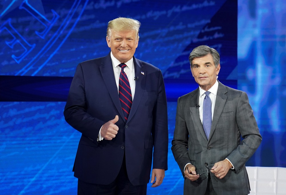 US President Donald Trump takes the stage with ABC News chief anchor George Stephanopoulos for a town hall event in Philadelphia, Pennsylvania September 15, 2020. — Reuters pic