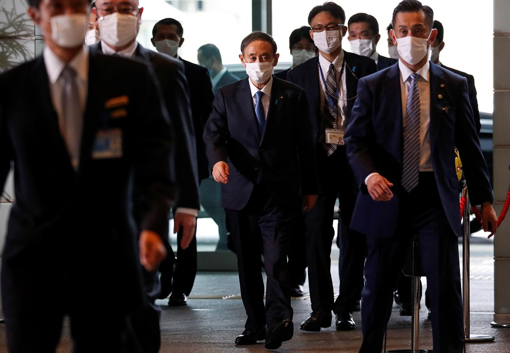 Japan's newly-elected Prime Minister Yoshihide Suga arrives at his official residence in Tokyo September 16, 2020. — Reuters pic
