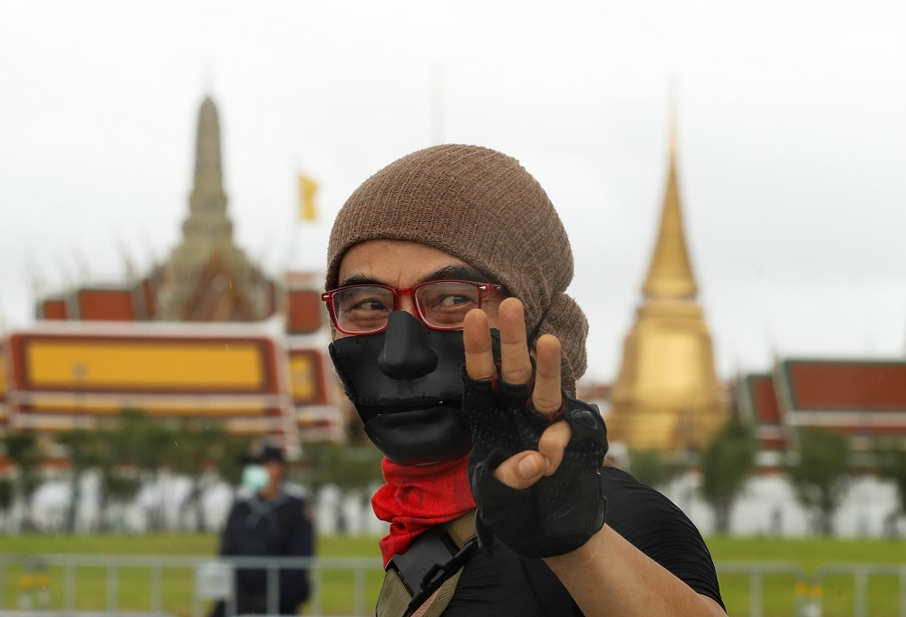 A pro-democracy protester makes a three-fingers salute at the Sanam Luang park as he arrives at a mass rally in Bangkok September 19, 2020. — Reuters pic