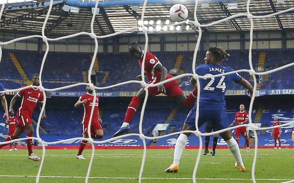 Liverpool's Sadio Mane scores their first goal against Chelsea at Stamford Bridge in London September 20, 2020. — Picture by Pool via Reuters