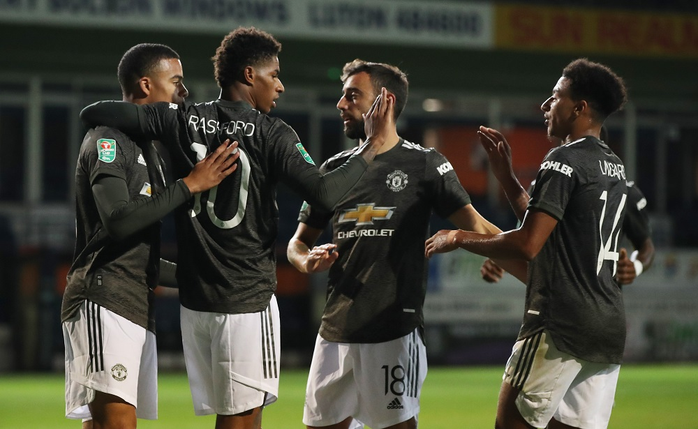 Manchester United's Marcus Rashford celebrates scoring their second goal with teammates during the Carabao Cup Third Round match against Luton Town at Kenilworth Road in Luton September 22, 2020. — Picture by Pool via Reuters