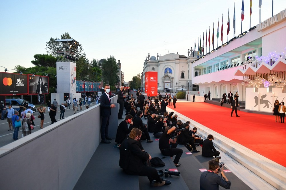 A general view shows press photographers waiting for guests to arrive at the festival's palace for the screening of the film 'Nomadland' presented in competition on the tenth day of the 77th Venice Film Festival September 11, 2020. — AFP pic