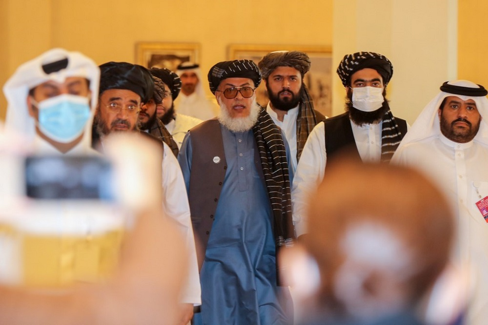 Taliban negotiator Abbas Stanikzai (centre) arrives for the opening session of the peace talks between the Afghan government and the Taliban in the Qatari capital Doha September 12, 2020. — AFP pic