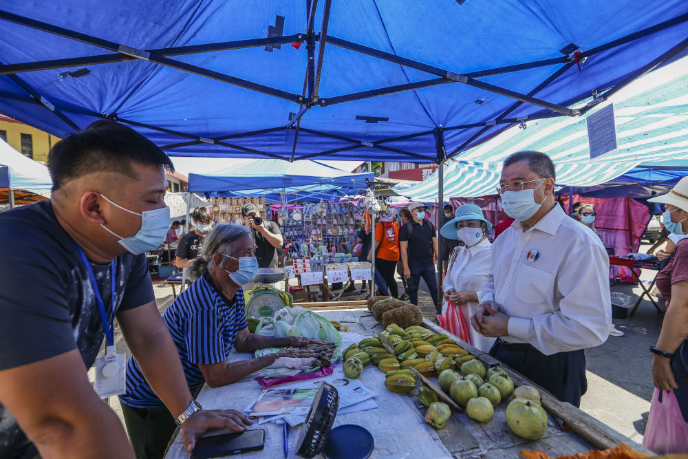 PBS party candidate for the Api-Api constituency Parti Bersatu Sabah (PBS) deputy president Datuk Dr Yee Moh Chai during a walkabout at the Gaya Street (Sunday Market) in Kota Kinabalu, Sabah September 13, 2020. — Picture by Firdaus Latif