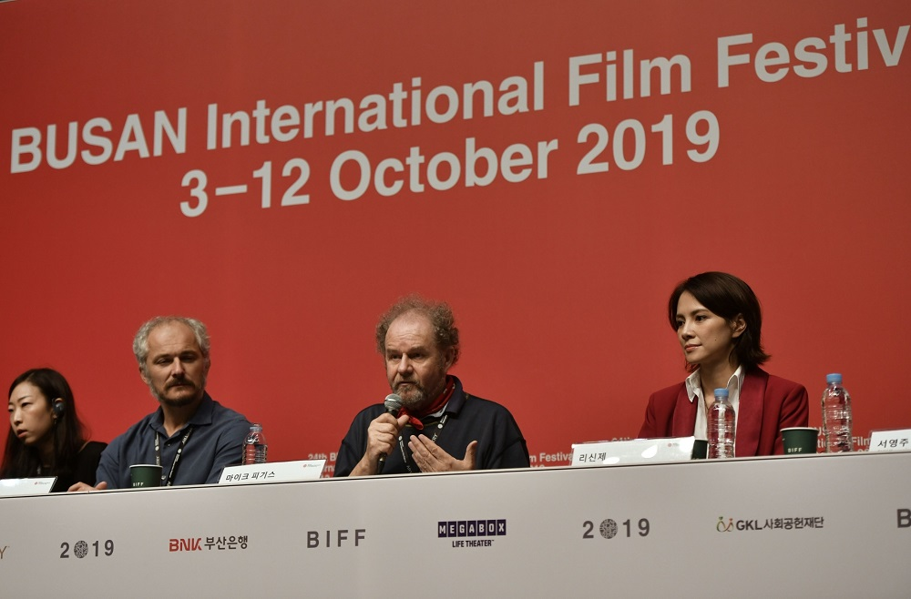 British film director Mike Figgis (centre) speaks during a press conference for the New Currents Jury for the 2019 Busan International Film Festival (BIFF) in Busan. — AFP pic