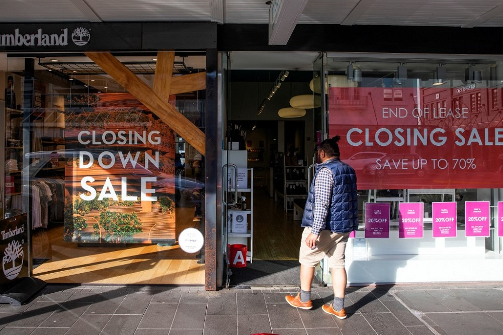 A shopper makes his way into a store offering a closing down sale in Auckland June 19, 2020. — AFP pic
