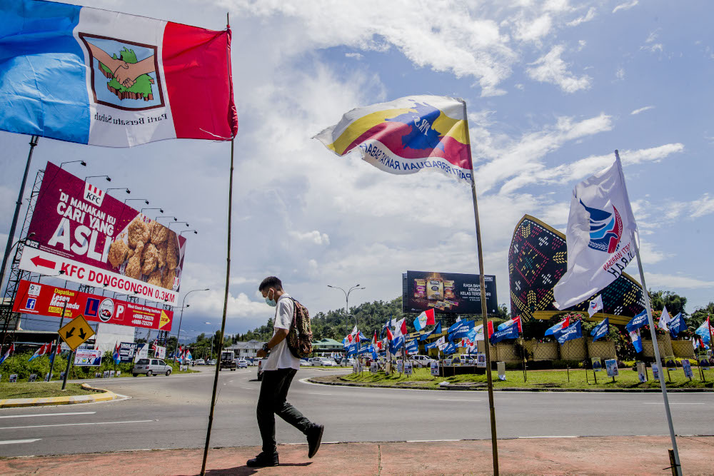Party flags are seen during the Sabah state election campaign in Donggongon, Penampang, Sabah September 21, 2020. — Picture by Firdaus Latif