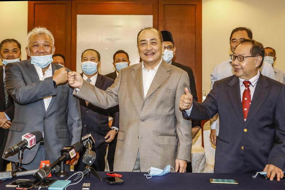 (From left) Datuk Seri Bung Moktar Radin, Datuk Hajiji Noor and Datuk Jeffrey Kitingan pose for a photo after a press conference at the Magellan Sutera Resort in Kota Kinabalu September 28, 2020. — Picture by Firdaus Latif