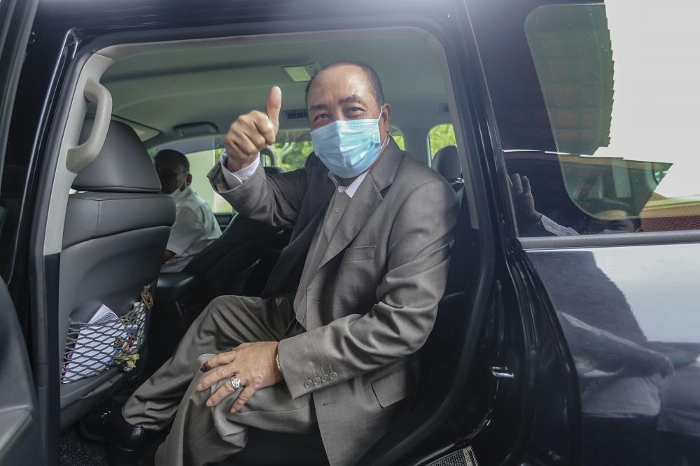 Sabah Bersatu chief Datuk Hajiji Noor leaves Magellan Sutera Resort following a press conference in Kota Kinabalu September 28, 2020. — Picture by Firdaus Latif