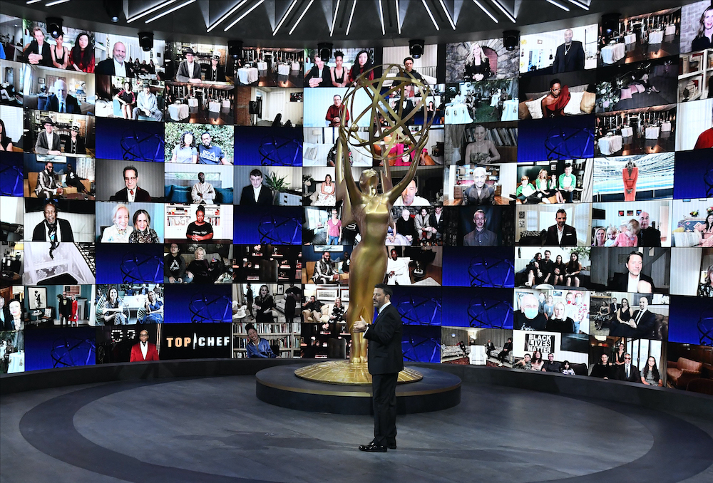 This handout picture released courtesy of Image Group LA/American Broadcasting Companies, Inc/ABC shows host Jimmy Kimmel in front of a wall of nominees watching remotely during the 72nd Primetime Emmy Awards ceremony held virtually. — Handout via AFP