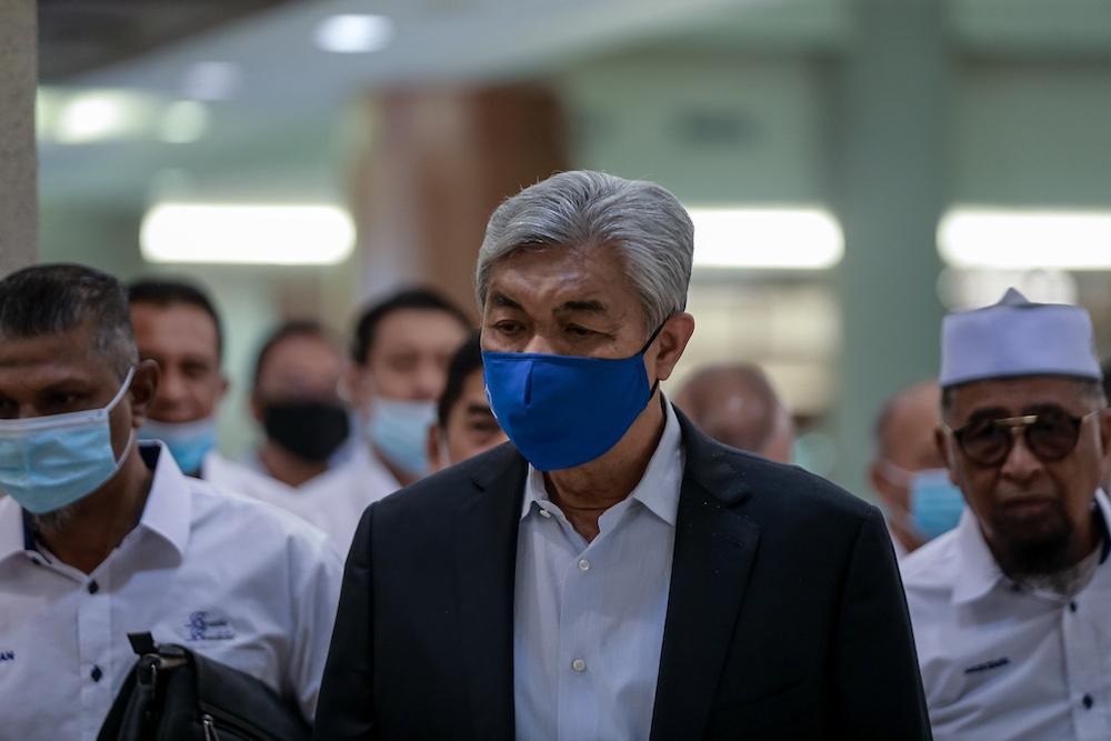 Datuk Seri Ahmad Zahid Hamidi arrives at the Kuala Lumpur High Court in Kuala Lumpur September 21, 2020. — Picture by Ahmad Zamzahuri