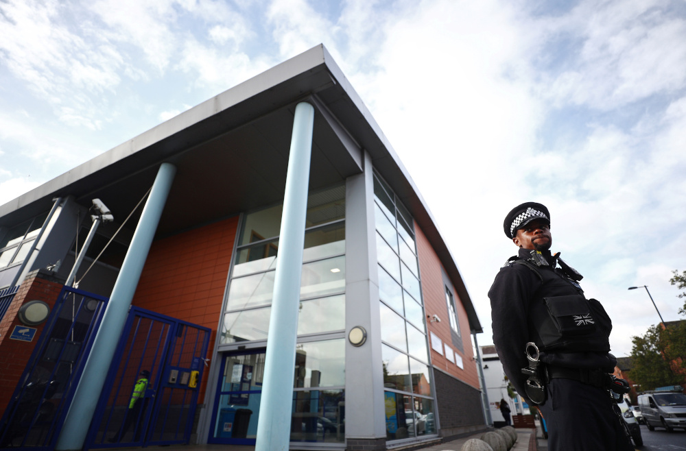 A policeman stands guard outside the custody centre where a British police officer has been shot dead in Croydon, south London, Britain, September 25, 2020. — Reuters pic