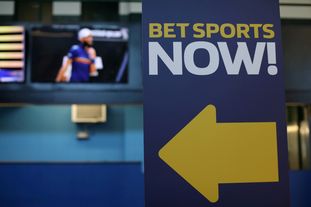 A sign is seen at Monmouth Park Sports Book by William Hill, ahead of the opening of the first day of legal betting on sports in Oceanport, New Jersey, US, June 14, 2018. The deal values each William Hill share at 272 pence, up 58 per cent compared with its closing price at the start of September when Caesars made an initial approach. — Reuters pic