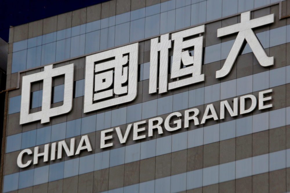 The future of China Evergrande Group has been thrown into doubt as it struggles to cover repayments on debts totalling more than US$120 billion, with a letter last week circulating on Chinese social media appearing to show it asking the government in Guangdong for help. — Reuters pic