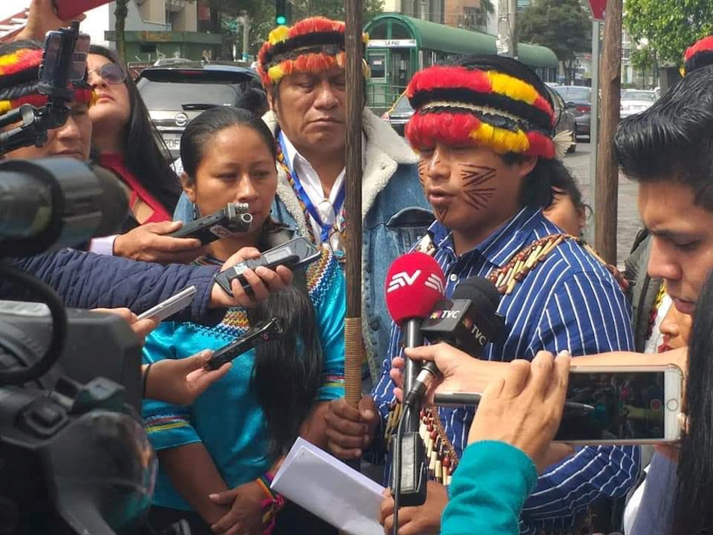 File photo of representatives of the Shiwiar, Sapara and Kichwa indigenous communities gather to deliver a statement opposing the government's state's auction of oil blocks without the free, prior and informed consent of affected communities, in Quito, Ec