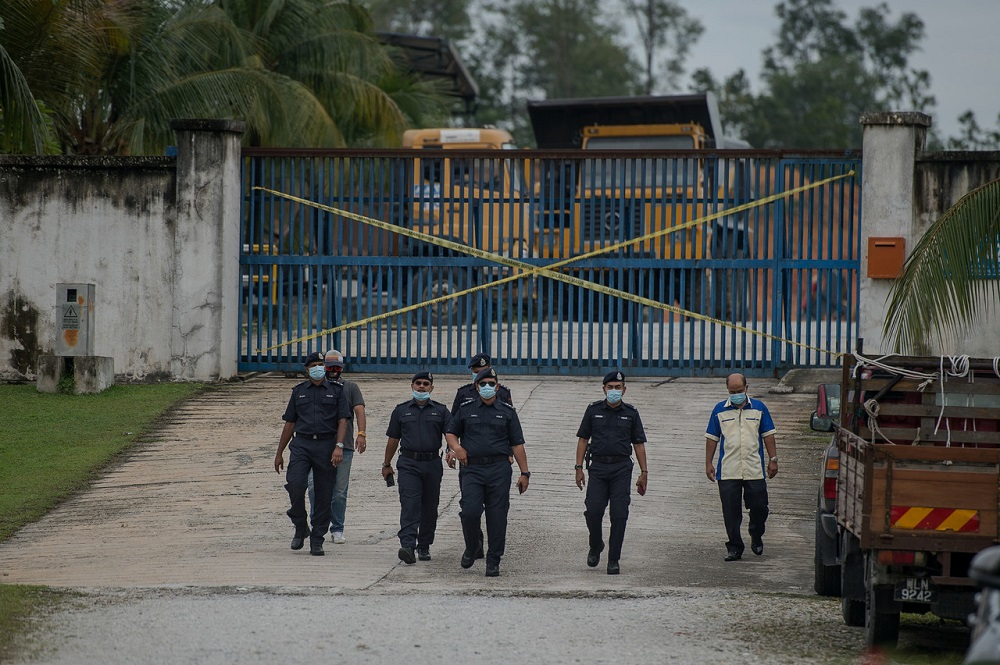 Police personnel are seen outside the factory alleged to be the source of the Sungai Selangor water pollution, in Rawang September 5, 2020. — Bernama pic