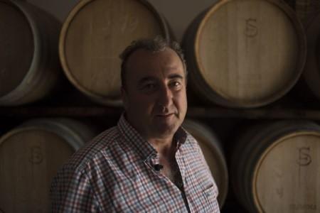 Federico Schatz, German owner of Schatz Wineries, poses in front of wine barrels in Ronda. — AFP-Relaxnews pic
