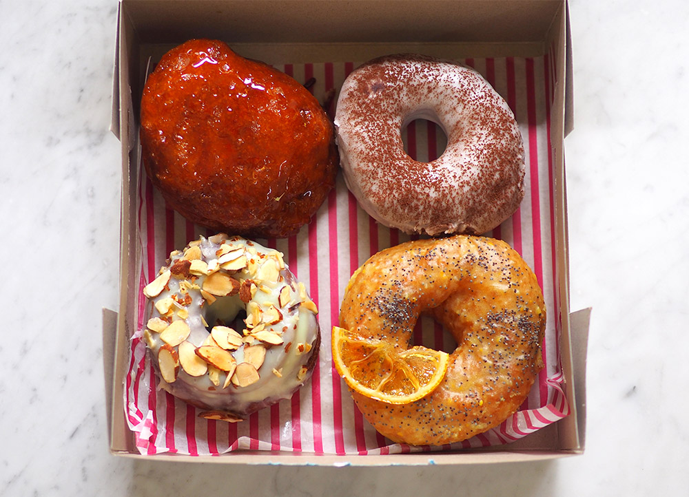 Get happiness delivered to your doorstep with Halo Doughnut's sourdough doughnuts (clockwise from top left) with their Créme Brûlée, Brown Baby, Lemon Pop and Almond White. — Pictures by Lee Khang Yi
