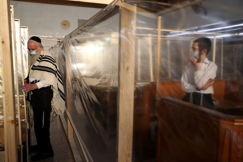 Jewish worshippers pray the morning pray in a synagogue which is fitted with plastic sheets for protection before Israel will enter a second nationwide lockdown amid a resurgence in new coronavirus disease cases, forcing residents to stay mostly at home during the Jewish high-holiday season, in Jerusalem September 18, 2020. — Reuters pic