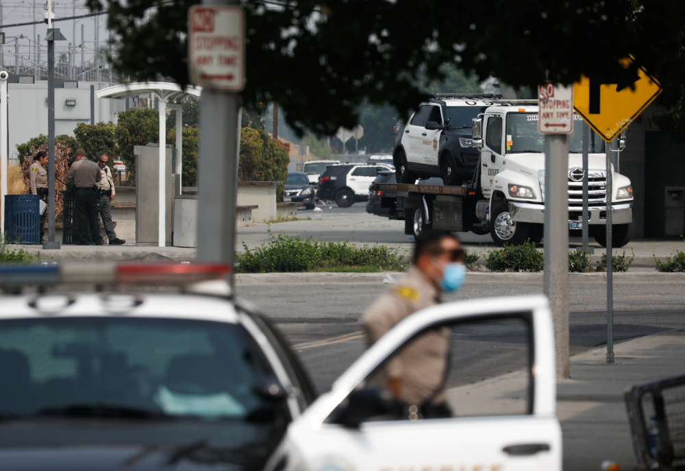 A Los Angeles County Sheriff's Department vehicle is towed from the scene where two deputies were shot in an ambush style shooting in Compton, California, September 13, 2020. — Reuters pic