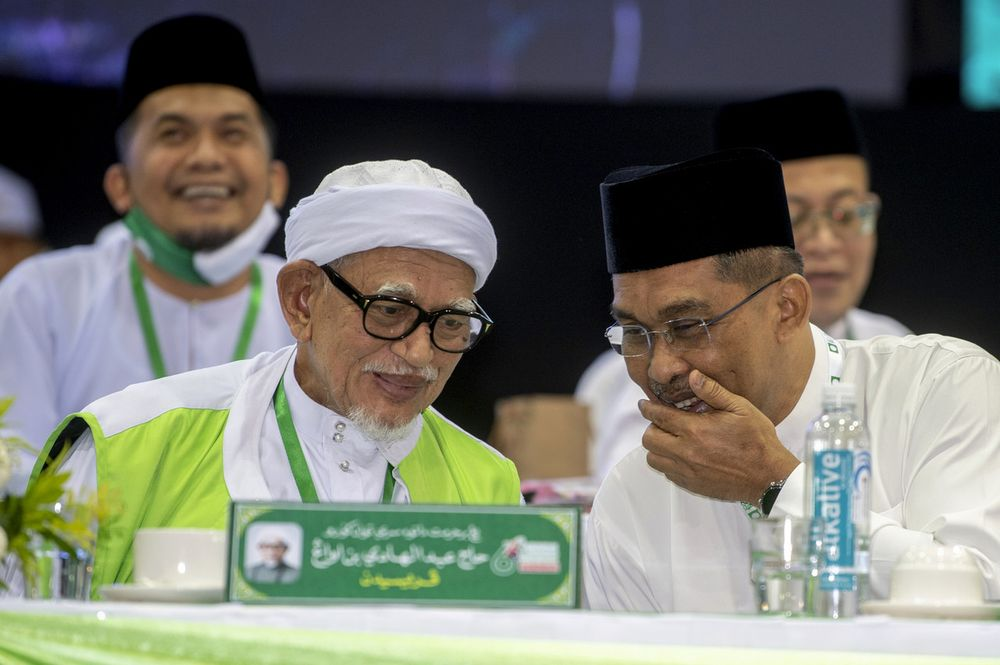 PAS President Datuk Seri Abdul Hadi Awang (left) with PAS Secretary-General Datuk Takiyuddin Hassan (right) after delivering the opening speech of the 66th PAS Annual Congress at the Kelantan Islamic Training Center in Pengkalan Chepa, September 13, 2020. — Bernama pic