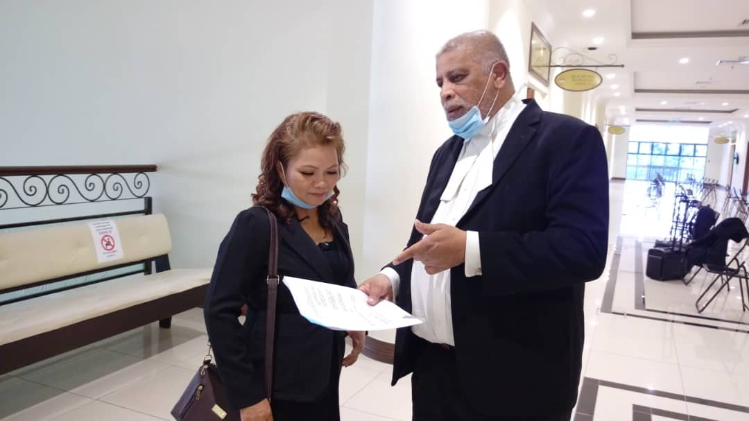 Marcel (right) and Margret outside the courtroom after their application for a leave to commence judicial review struck out by the High Court.
