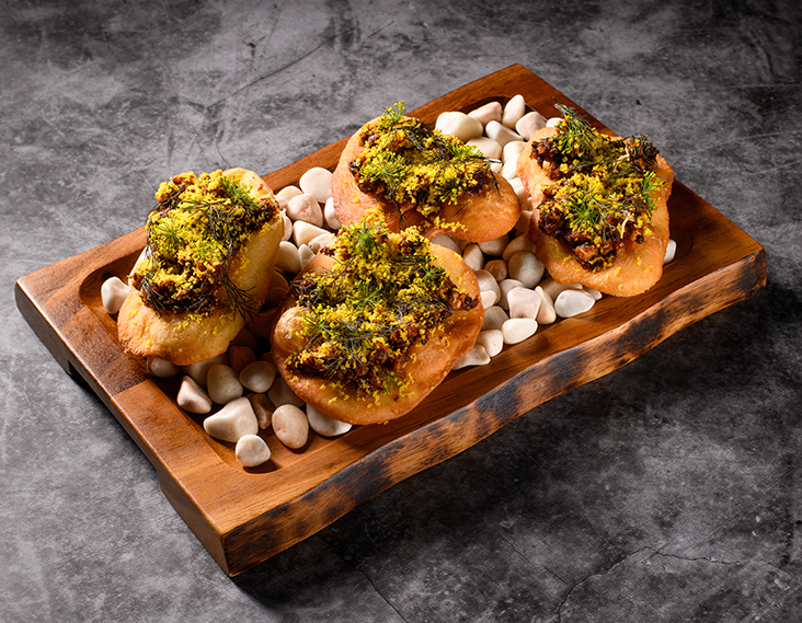 'Black Forest' has a sweet, savoury black onion sambal on top of deep fried bread sprinkled with finely grated cured egg yolk and fennel fronds