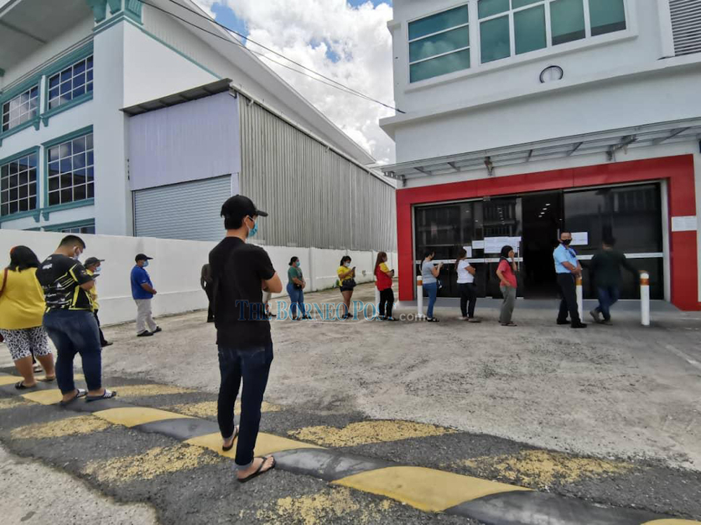 Poslaju customers in East Malaysia waiting to collect their parcels in this file photo. — Borneo Post pic