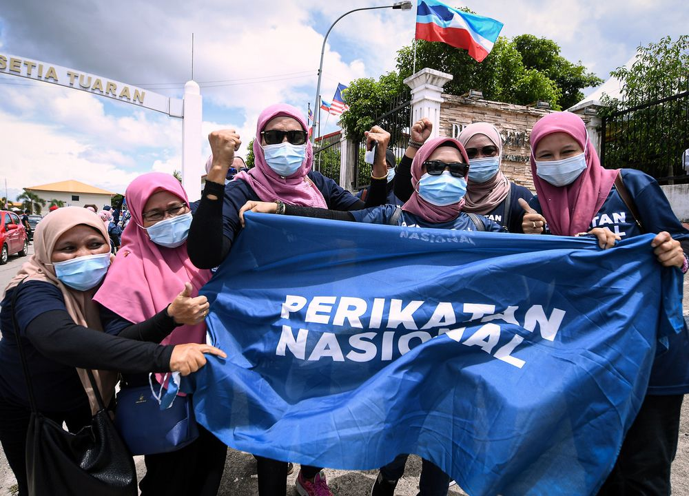 Perikatan Nasional supporters cheering after the announcement of candidates for N.12 Sulaman constituency in conjunction with the Sabah State Election at Dewan Seri Sulaman, Tuaran, Sept 12, 2020. — Bernama pic