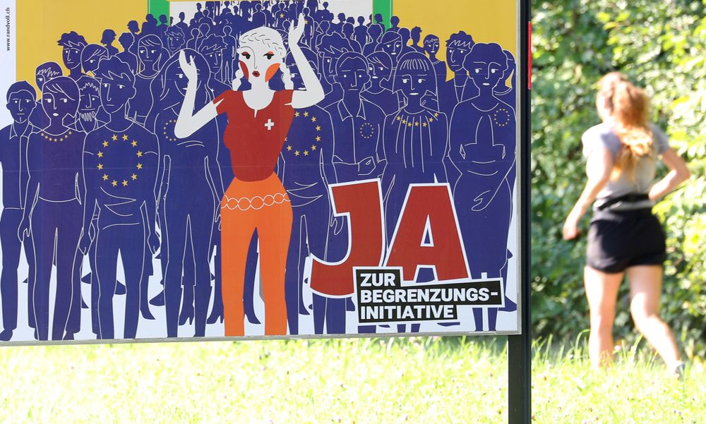 A poster of the Action for an independent and neutral Switzerland (AUNS) reading: 'It's getting tight -Yes to the anti-immigration initiative' is seen in Adliswil, Switzerland September 15, 2020. — Reuters pic