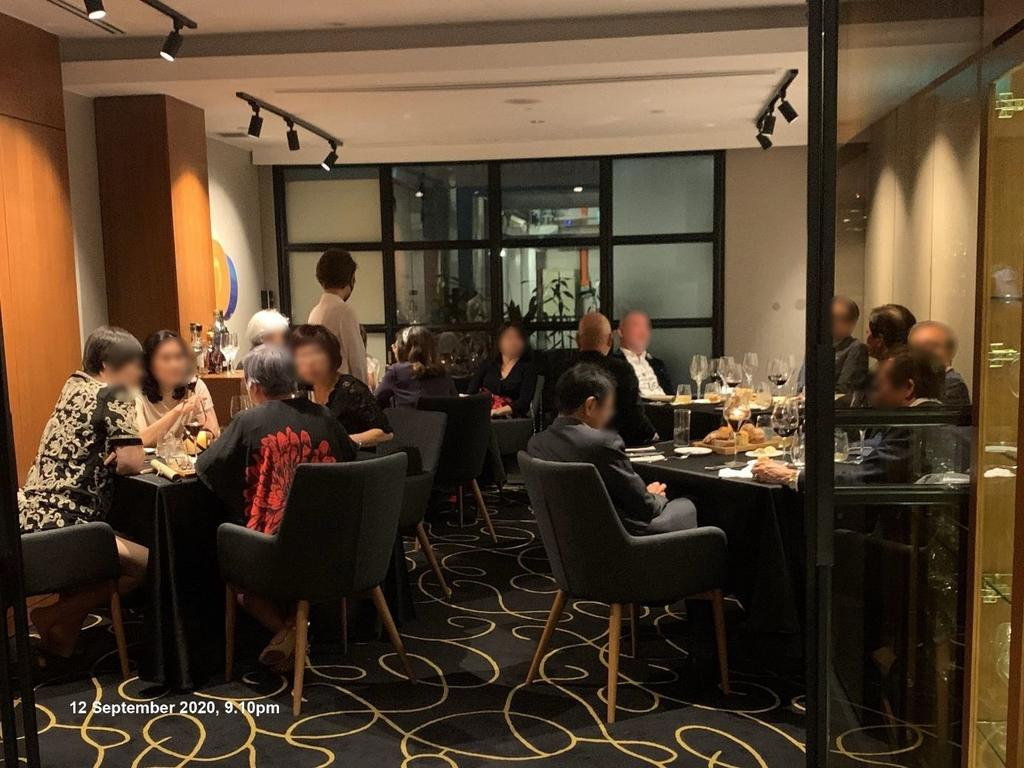 15 individuals found inside a restaurant at 39 Hong Kong Street were seated across four tables and intermingling on September 12, 2020 at 9.10pm. ― TODAY pic