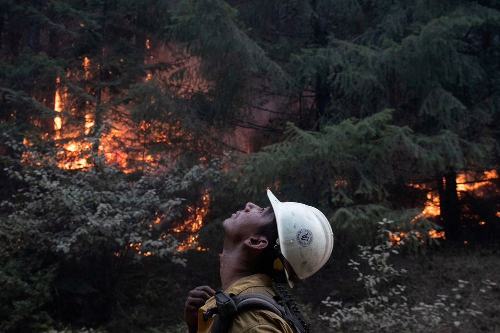 Johnny Islas, a firefighter from Las Vegas, monitors ambers from a firing operation near the Obenchain Fire in Butte Falls, Oregon, US, September 15, 2020. — Reuters pic
