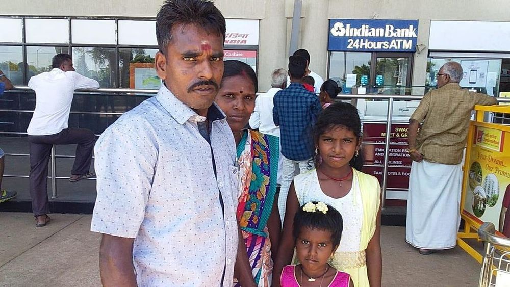 Alagu Periyakarrupan (left) with his wife A Panjali and their two younger daughters Ranjini, 11, and Rekha, six.l — A Panjali and ItsRainingRaincoats pic via TODAY