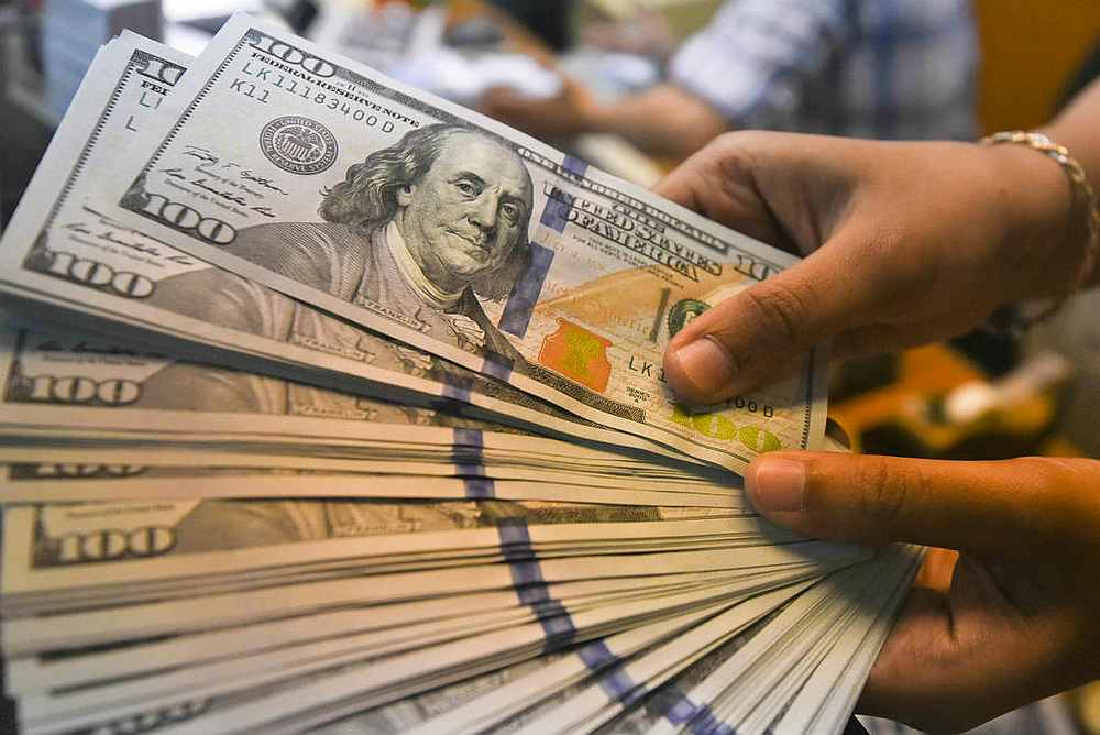 The US dollar edged lower against major currencies today as risk appetite recovered across markets, after Federal Reserve officials helped calm jitters this week about accelerating US inflation. — Reuters pic
