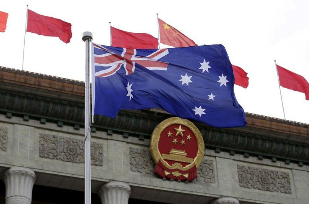 An Australian flag flutters in front of the Great Hall of the People during a ceremony in Beijing, China, April 14, 2016. — Reuters pic