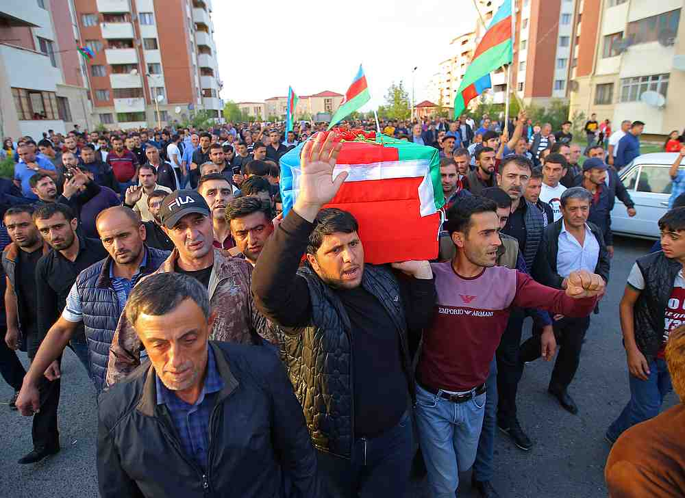 People carry the coffin of a member of Azerbaijani Armed Forces, who was allegedly killed during the fighting over the breakaway region of Nagorno-Karabakh, during a funeral in Azerbaijan September 29, 2020. — Reuters pic