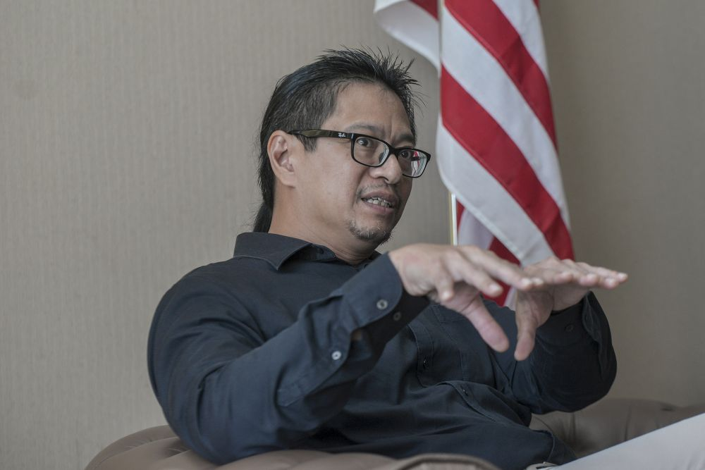 Election Commission deputy chairman Azmi Sharom talks about the challenges of having a sudden surge in the number of voters after the automatic voter registration is sorted out. — Picture by Shafwan Zaidon
